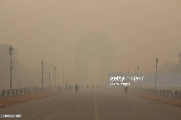 A general view of smoggy morning as India Gate in the backdrop is seen engulfed with dense smog in the early morning in New Delhi The air quality in...