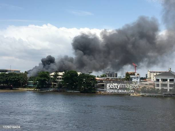 General view of smoke arising from the Ikoyi prison that is on fire in Lagos on October 22, 2020. - Gunshots could be heard on October 22, 2020 and...
