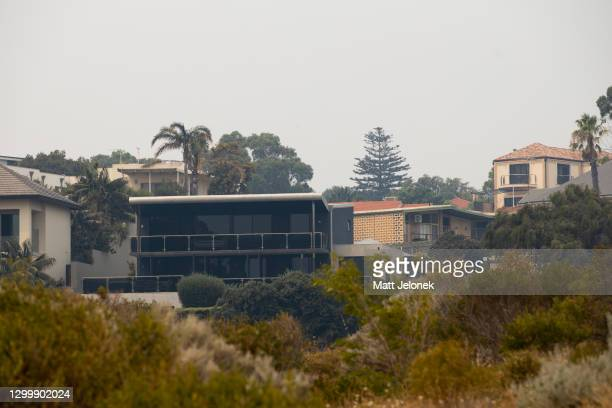 General view of smoke haze is seen across residential properties on February 2, 2021 in Perth, Australia. Up to 30 homes are feared lost as...