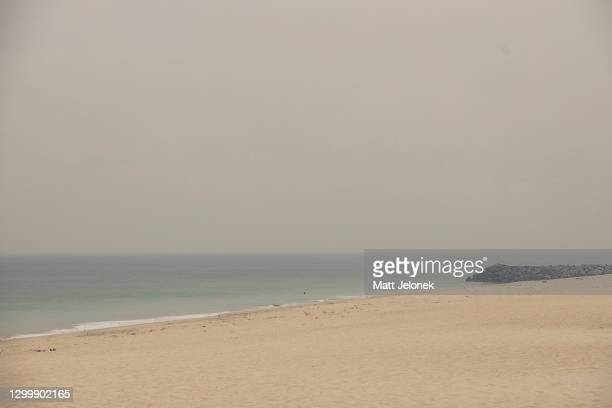 General view of smoke haze is seen along the coastline on February 2, 2021 in Perth, Australia. Up to 30 homes are feared lost as firefighters...