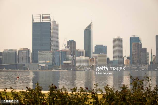 General view of smoke haze is seen blanketing the city skyline on February 2, 2021 in Perth, Australia. Up to 30 homes are feared lost as...