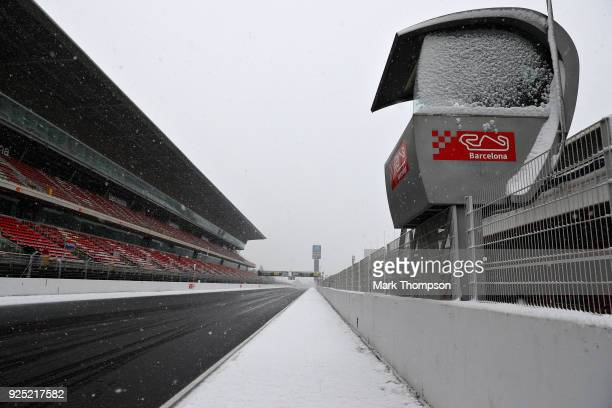 General view of snow on the pit straight during day three of F1 Winter Testing at Circuit de Catalunya on February 28, 2018 in Montmelo, Spain.