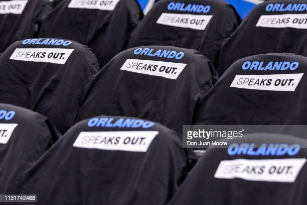 A general view of some give away shirts Orlando Speaks Out on the seats of fans before the game with the Orlando Magic and the New Orlean Pelicans at...