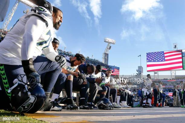 A general view of some of the Seattle Seahawks as they sit on their sidelines during the National Anthem before the game against the Jacksonville...