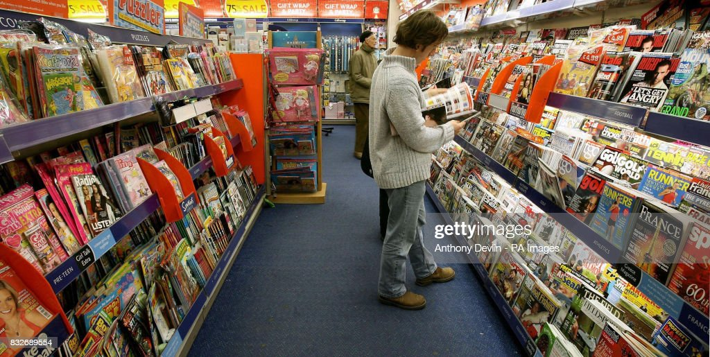 A general view of someone reading a magazine inside a WH Smith store