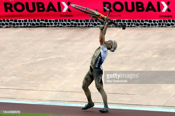 General view of Sonny Colbrelli of Italy and Team Bahrain Victorious lifts his bicycle to celebrates winning in the Roubaix Velodrome - Vélodrome...
