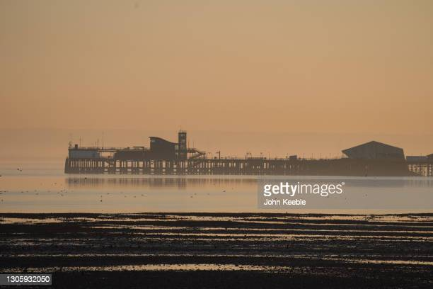 General view of Southend pier as the sun goes down at low tide on February 27, 2021 in Southend-on-Sea, England.