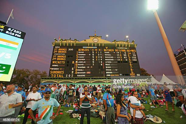 A general view of spectators on the hill as the sun sets during the 2015 ICC Cricket World Cup match between India and Pakistan at Adelaide Oval on...