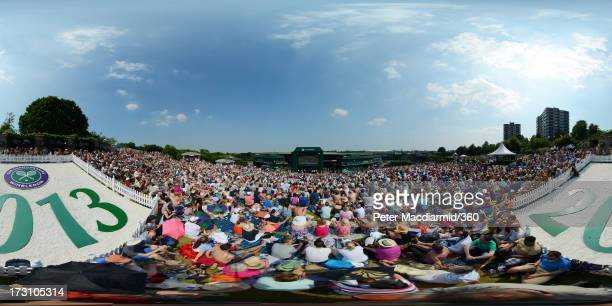 General view of spectators watching a giant TV screen from Murray Mound broadcasting the Gentlemen's Singles Final match between Andy Murray of Great...