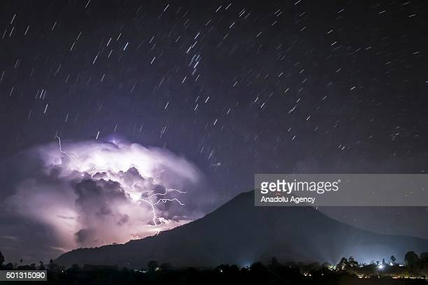 A general view of spewing pyroclastic and thunderbolt during Mount Sinabung volcano eruption seen from Tiga Pancur village on February 21 2015 in...