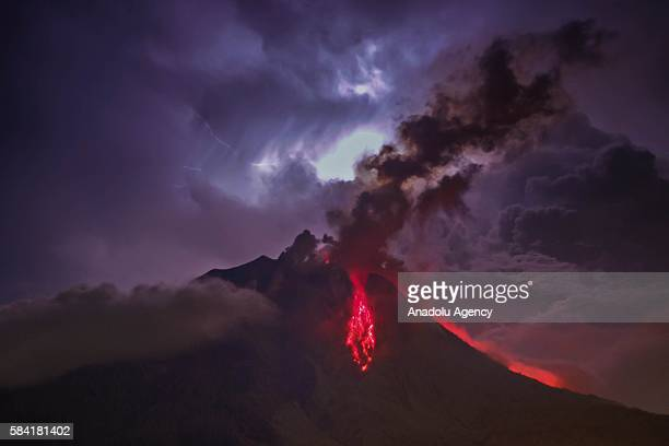 A general view of spewing pyroclastic lava is seen during Mount Sinabung volcano eruption seen from Tiga Pancur village in Karo North Sumatra...