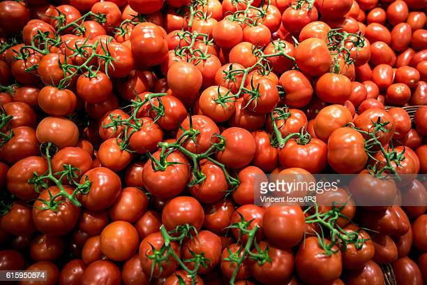General view of stalls of fresh and organic tomatoes during the inauguration of a new range of Bio signs by French President of Monoprix Regis...