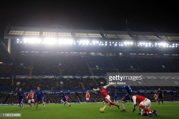 A general view of Stamford Bridge as Bukayo Sako of Arsenal takes on Callum HudsonOdoi of Chelsea during the Premier League match between Chelsea FC...