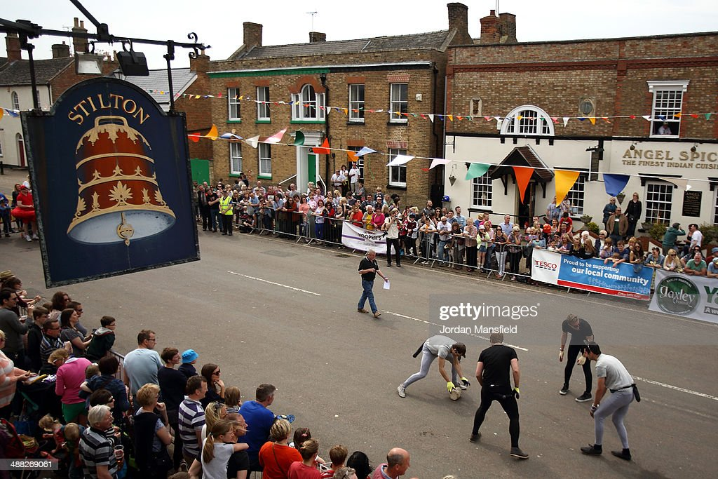 A general view of Stilton High Street as teams participate in the cheese rolling competition on May 5, 2014 in Stilton, England. The Stilton annual cheese rolling competition, which is held annually on every May Day Bank Holiday involves teams of four competing against each other by rolling cheese down the High Street to be crowned the 'Stilton Cheese Rolling Champions'.
