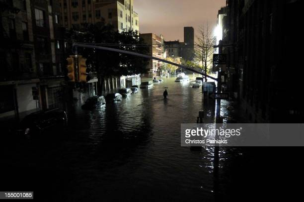 A general view of submerged cars on Ave C and 7th st after severe flooding caused by Hurricane Sandy on October 29 2012 in Manhattan New York The...