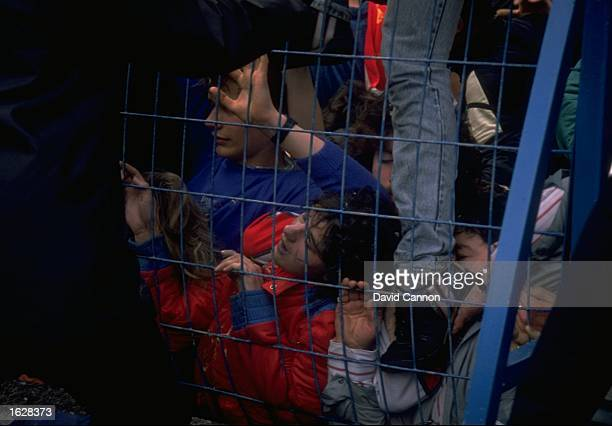 General view of supporters squashed against a fence in the disaster before the FA Cup Semi-Final between Liverpool and Nottingham Forest at...