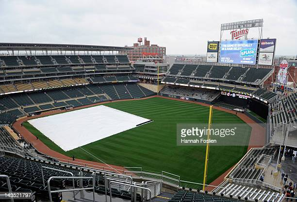 A general view of Target Field while the tarp is on the field as rain delays the start of the game between the Minnesota Twins and the Kansas City...