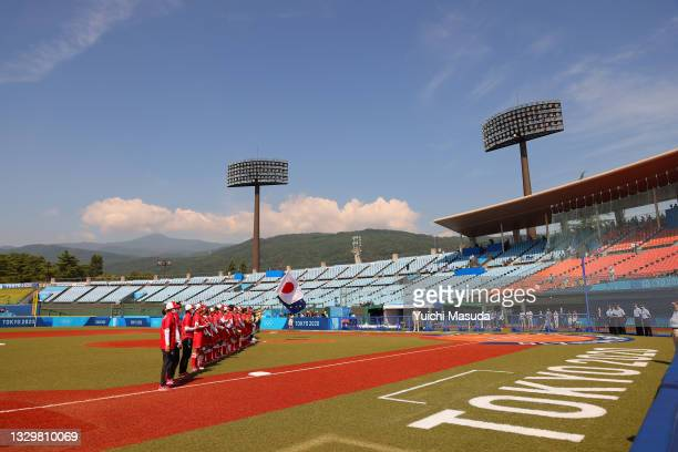 General view of Team Australia and Team Japan standing in the infield for pregame ceremonies before to their game during the Tokyo 2020 Olympic Games...