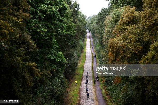 General view of Team INEOS Grenadiers passing through Drève des Boules d'Hérin - Tranchée Wallers Arenberg cobblestones sector during the 118th...