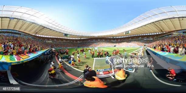 A general view of teams as they enter the field before the 2014 FIFA World Cup Brazil Group G match between Portugal v Ghana at Estadio Nacional on...