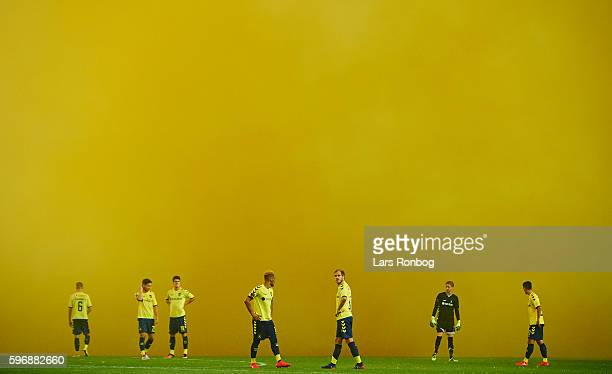 General view of that players from Brondby IF waiting in the smoke from the Brondby fans pyrotechnics during halftime in the Danish Alka Superliga...