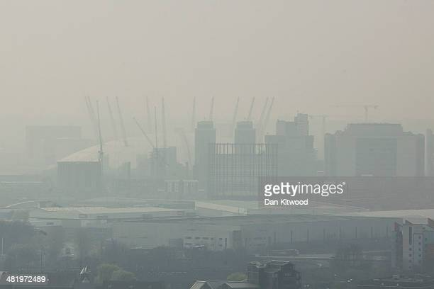 A general view of the 02 Arena through smog on April 2 2014 in London England Dust from the Sahara combined with pollution from mainland Europe has...
