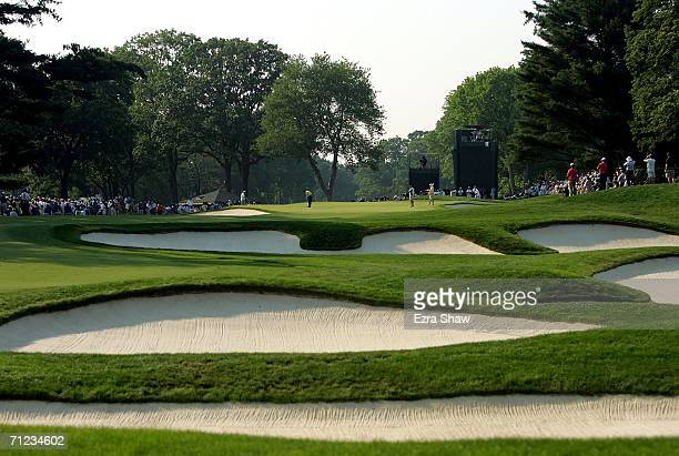 General view of the 12th hole as Phil Mickelson putts on the green during the final round of the 2006 US Open Championship at Winged Foot Golf Club...