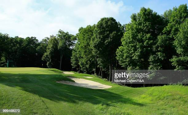 John Deere excavator fitted with a golf club is displayed during the fourth and final round of the John Deere Classic held at TPC Deere Run on July...