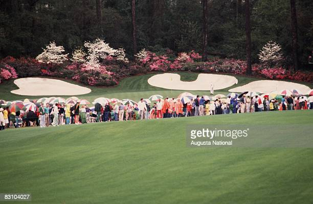 A general view of the 13th green a part of Amen Corner with patrons waiting for tournament action is seen during the 1983 Masters Tournament at...