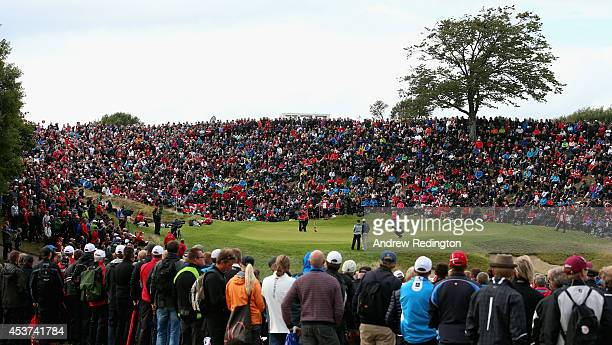 A general view of the 16th green as Thomas Bjorn of Denmark Oliver Fisher of England and Mikael Lundberg of Sweden play the hole during the final...