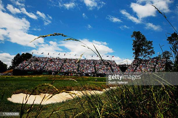 General view of the 17th green is seen as Tiger Woods of the United States, Adam Scott of Australia and Rory McIlroy of Northern Ireland play during...
