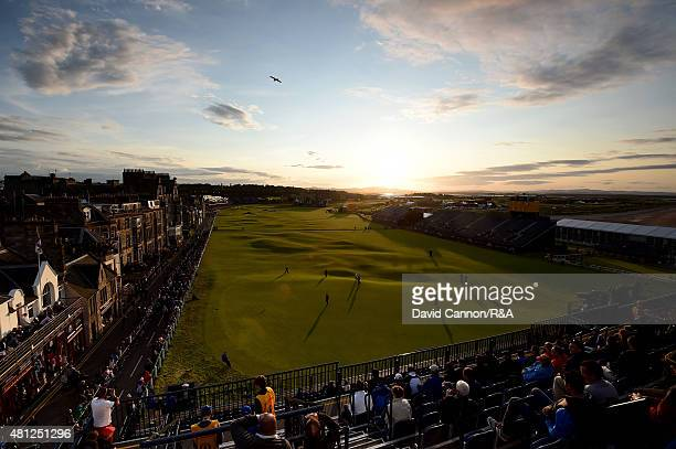 A general view of the 18th and first hole is seen as fans watch Paul Kinnear of the United States Scott Arnold of Australia and Tyrrell Hatton of...