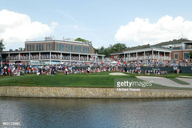 General view of the 18th green as Justin Rose of England looks over a putt during the final round of the Fort Worth Invitational at Colonial Country...