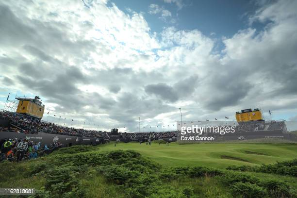 A general view of the 18th green as the group of Brooks Koepka of the United States Shubhankar Sharma of India and Louis Oosthuizen of South Africa...