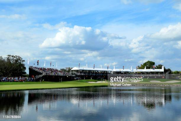 General view of the 18th green is seen as a gallery of fans watch play during the third round of the Arnold Palmer Invitational Presented by...