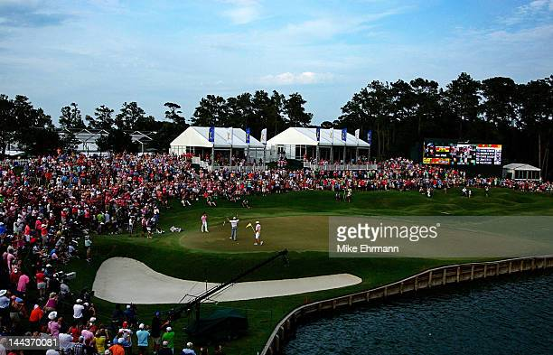 General view of the 18th green is seen as Matt Kuchar of the United States celebrates his two-stroke victory on the 18th hole during the final round...