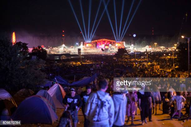 A general view of the 2017 Woodstock Festival Poland at night shows masses of people tents and the main stage with beams of light on August 4 2017 in...