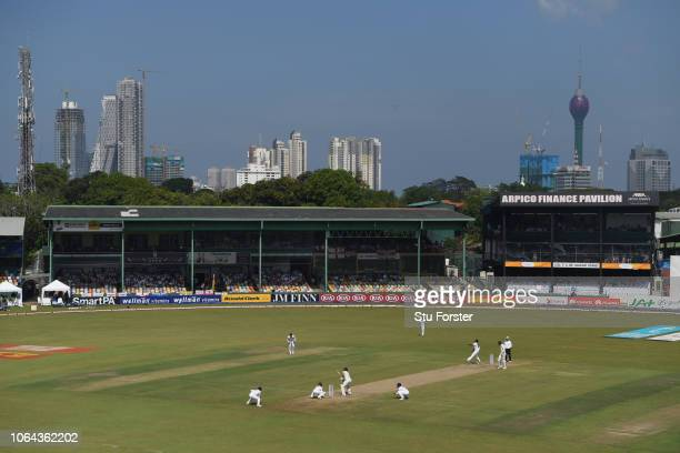 General view of the action against the Colombo skyline during Day One of the Third Test match between Sri Lanka and England at Sinhalese Sports Club...