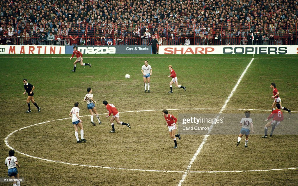 A general view of the action and the muddy Old Trafford pitch during a 6th Round FA Cup match between Manchester United and West Ham United at Old Trafford on March 9, 1985 in Manchester, England.