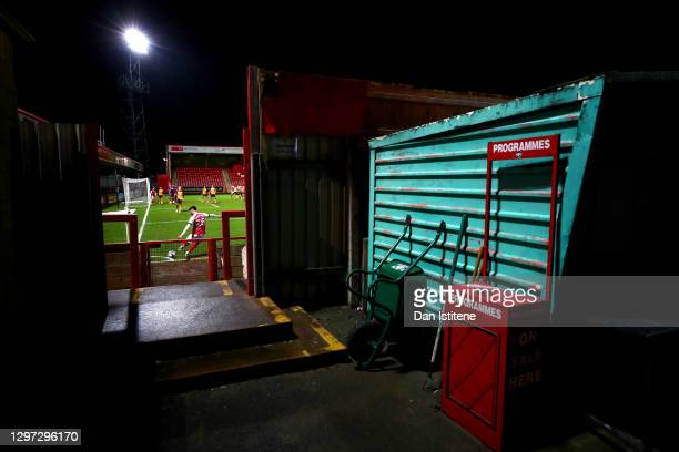 General view of the action as Ellis Chapman of Cheltenham Town takes a corner during the Sky Bet League Two match between Cheltenham Town and Newport...