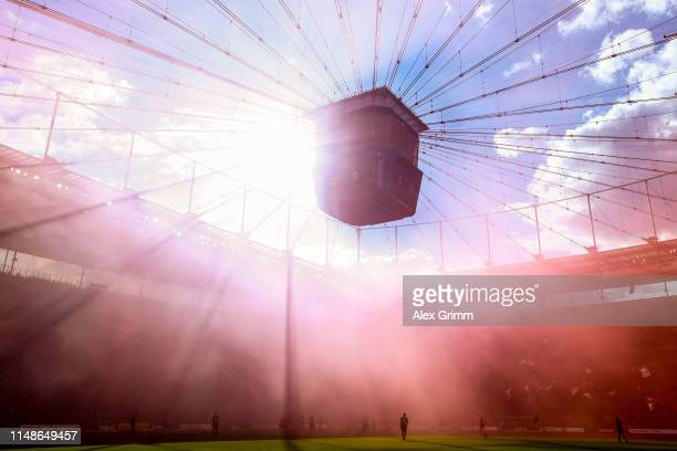 General view of the action as purple smoke from flares fills the air during the Bundesliga match between Eintracht Frankfurt and 1 FSV Mainz 05 at...