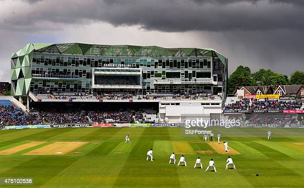 A general view of the action as rain falls in the distance during day one of the 2nd Investec test match between England and New Zealand at...