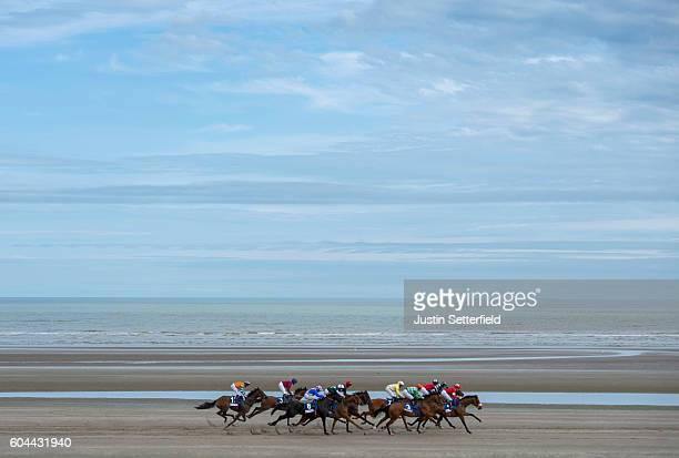 A general view of the action as riders and jockeys take part in the Laytown races on September 13 2016 in Laytown Ireland