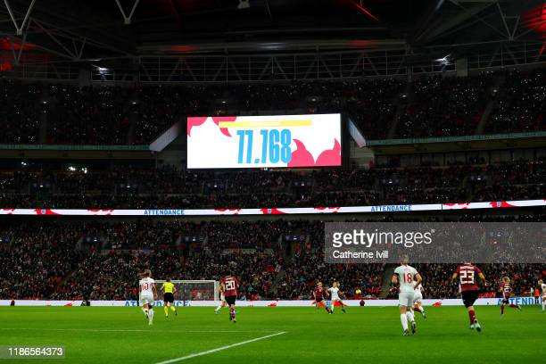 General view of the action as the record attendance figure of 77, 768 is announced on the video screen during the International Friendly between...