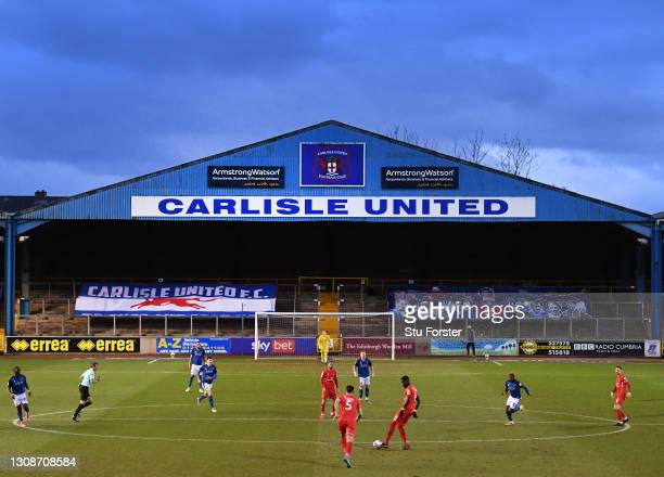 General view of the action at Brunton Park as the empty stands display banners during the Sky Bet League Two match between Carlisle United and Leyton...
