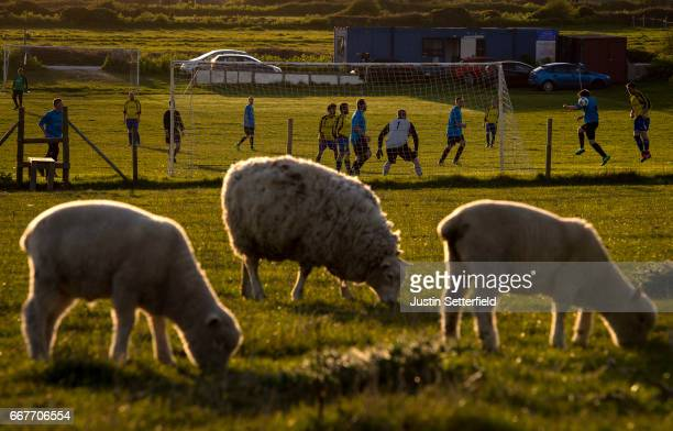 A general view of the action during an amateur non league football match at sunset on April 11 2017 in Portland England