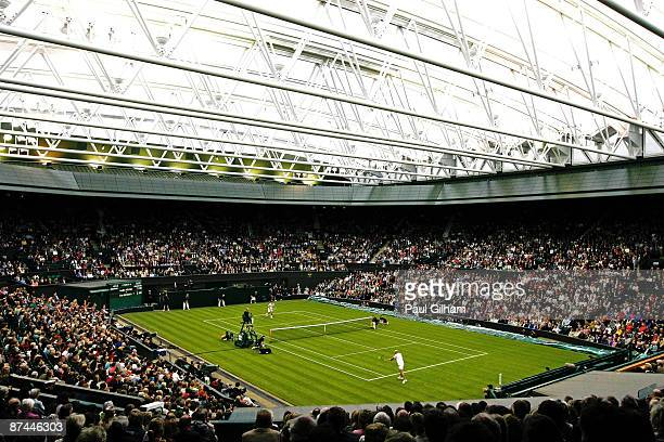 A general view of the action during the Mens Singles match between Andre Agassi and Tim Henman during the 'Centre Court Celebration' at Wimbledon on...