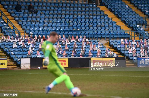 General view of the action infront of a bank of cardboard fans in an otherwise near deserted stand during the Sky Bet League Two match between...