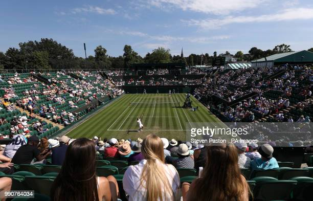 General view of the action on court two between Dominic Thiem and Marcos Baghdatis on day two of the Wimbledon Championships at the All England Lawn...