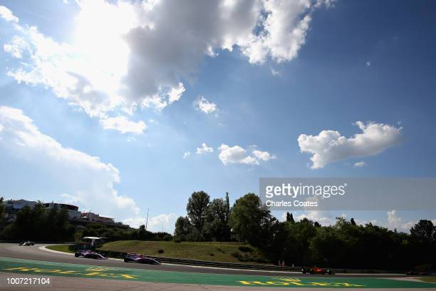 General view of the action showing Esteban Ocon of France driving the Sahara Force India F1 Team VJM11 Mercedes and Sergio Perez of Mexico driving...